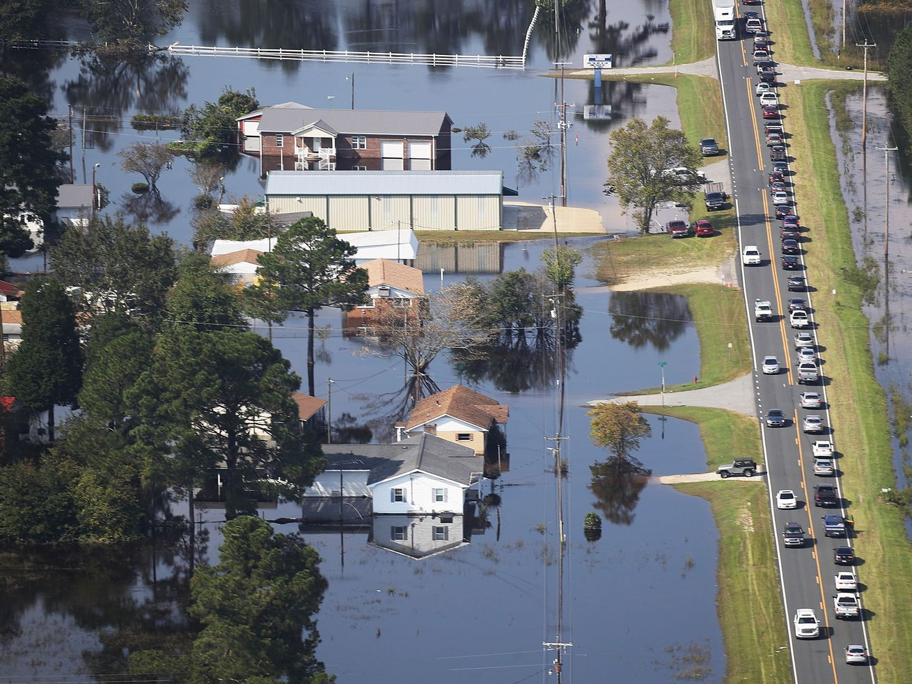 Floodwaters are seen surrounding homes after heavy rains from Hurricane Florence on September 20, 2018, in Lumberton, North Carolina. The rainfall from Hurricane Florence was a 1,000-year event.
