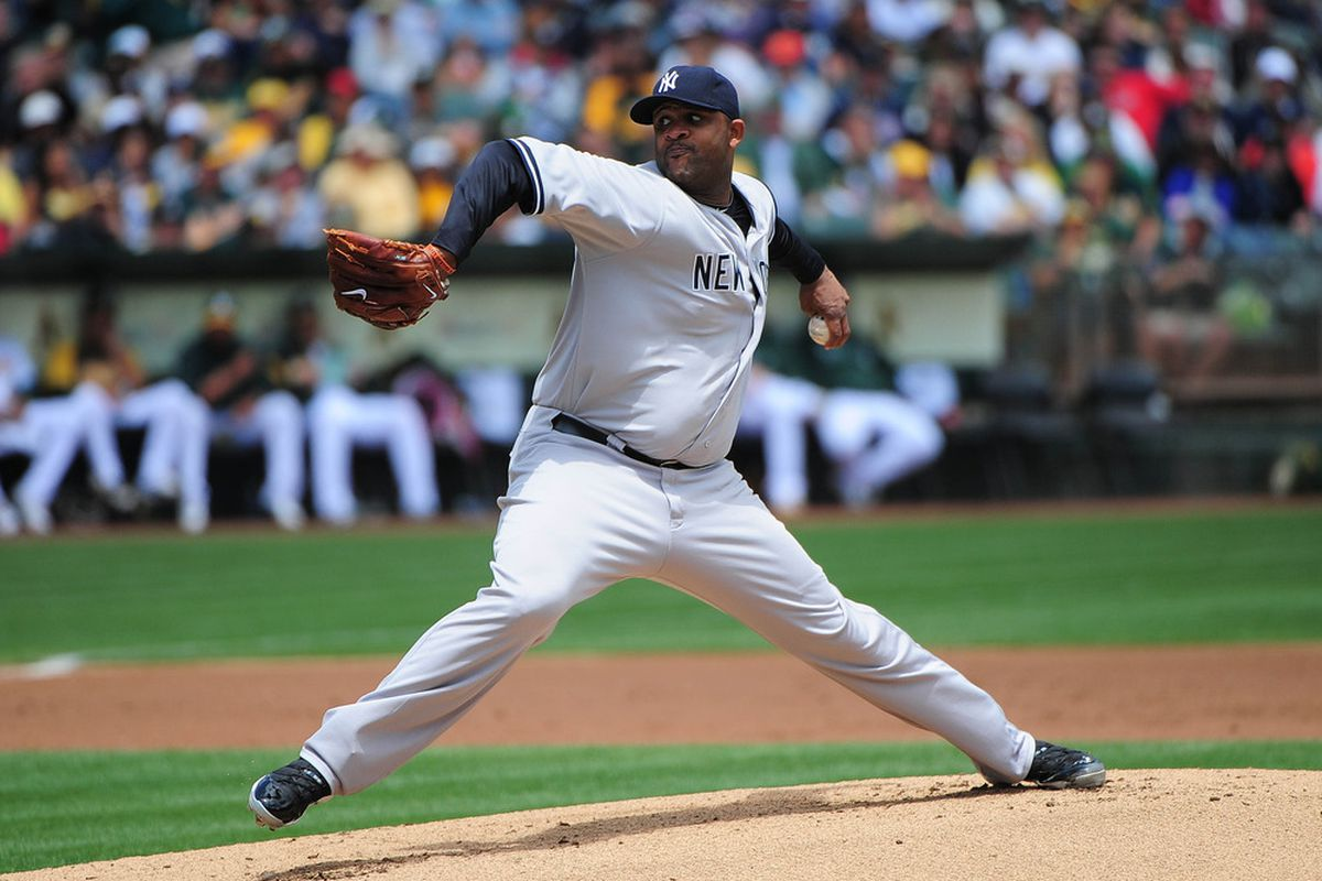 May 26, 2012; Oakland, CA, USA; New York Yankees starting pitcher CC Sabathia (52) delivers a pitch during the first inning against the Oakland Athletics at O.co Coliseum. Mandatory Credit: Kyle Terada-US PRESSWIRE