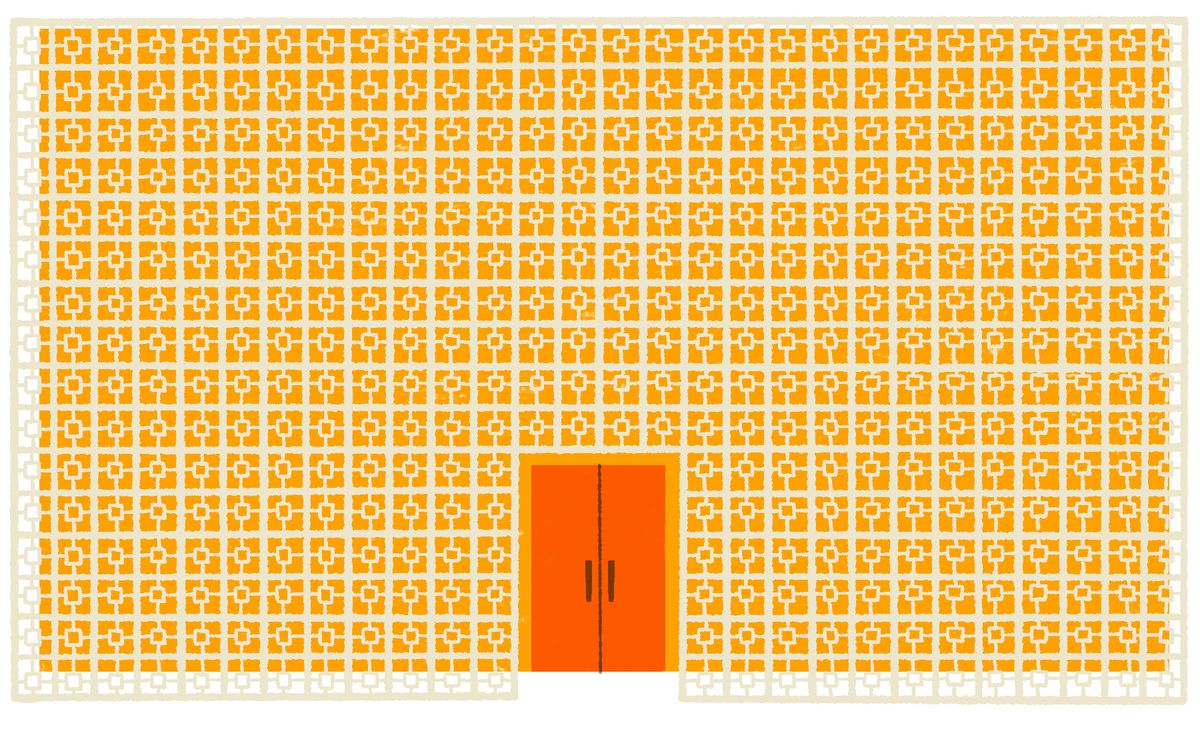 A large rectangle building made entirely of small geometric-shaped bricks, with a centered set of orange double doors. Illustration.
