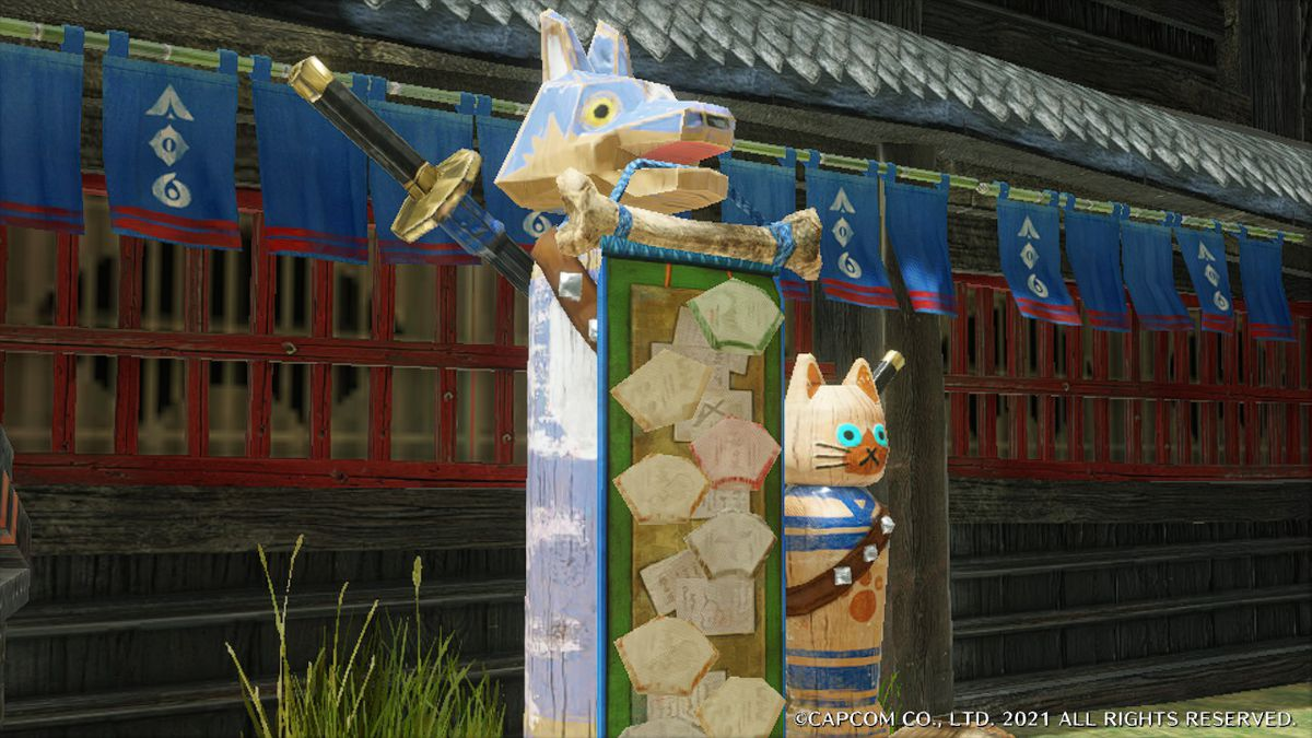 A wooden palamute and palico statue in Monster Hunter Rise