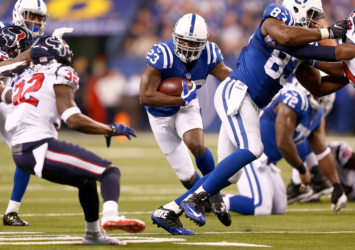 Indianapolis Colt Franke Gore runs with the ball against the Houston Texans