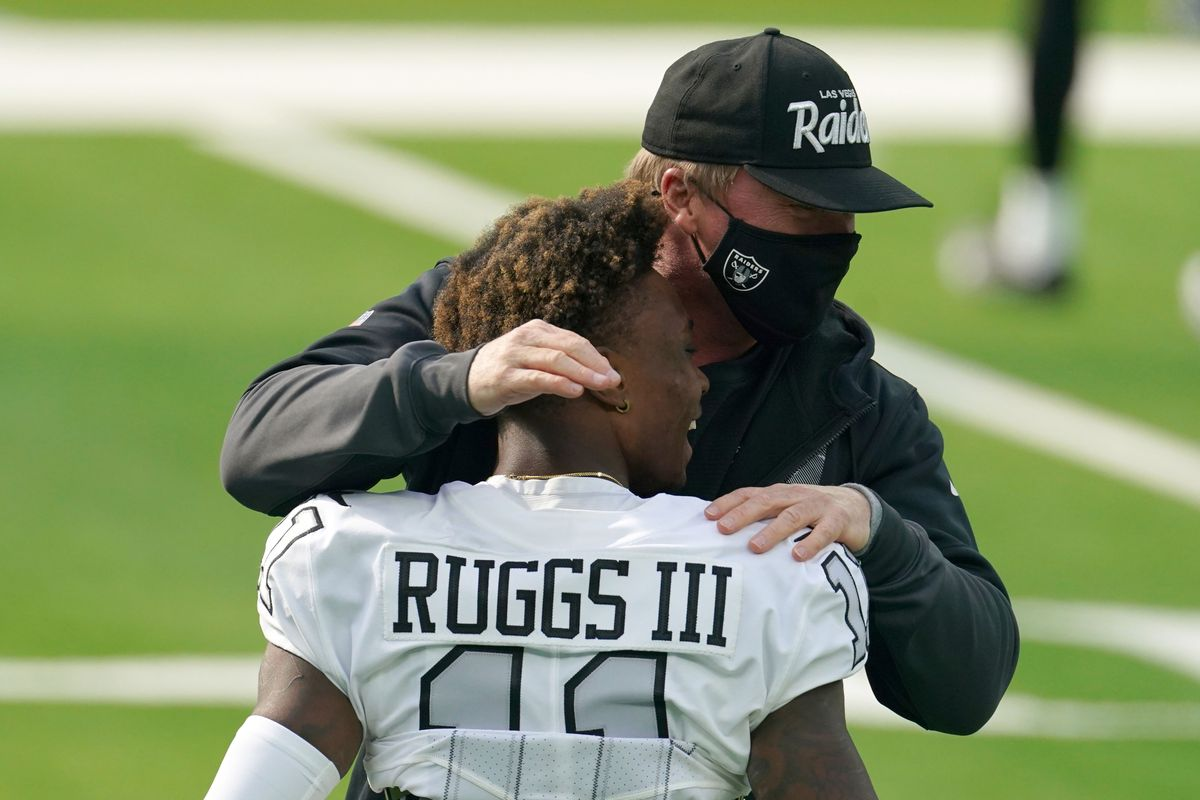 Las Vegas Raiders coach Jon Gruden embraces wide receiver Henry Ruggs III (11) before the game against the Los Angeles Chargers at SoFi Stadium.