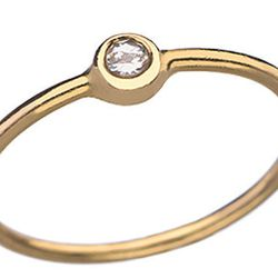 """<b>Maya Brenner</b> 14kt yellow gold ring with white diamond, $590 at <a href=""""http://www.maxandchloe.com/Maya-Brenner-White-Diamond-Stacking-Ring""""target=""""_blank"""">Max and Chloe</a>."""