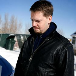 Josh Powell , the husband of Susan Powell, answers questions outside his Magna home on December 10, 2009.