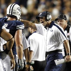 BYU's Head Coach Bronco Mendenhall yells at Brigham Young Cougars offensive linesman Braden Brown (75) to sit down as BYU and Utah play Saturday, Sept. 17, 2011