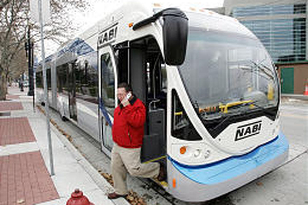 Jack Love steps off a Bus Rapid Transit on Tuesday in Salt Lake City. The bus is like TRAX but with rubber wheels and no rails or power lines.