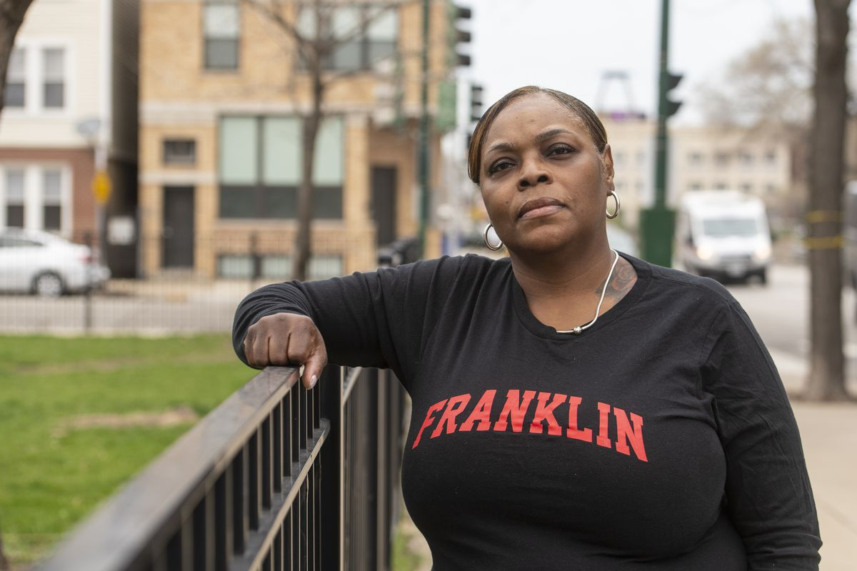 Faye Jenkins, a CPS cafeteria worker at Franklin Fine Arts Center, stands outside her apartment building, Monday, April 5, 2021.