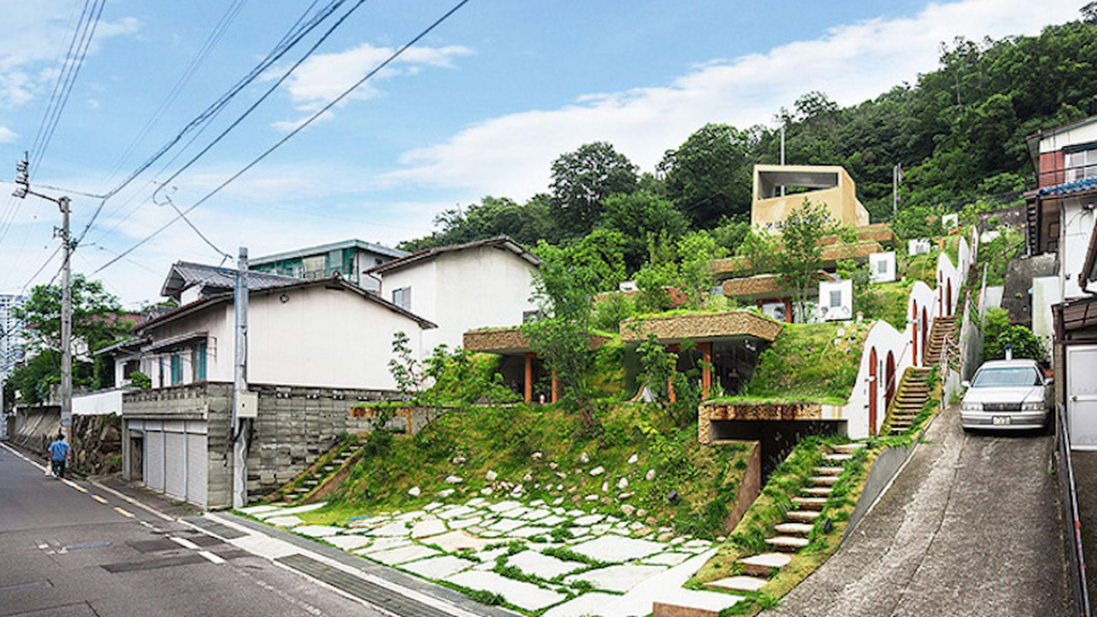 A hobbit style apartment building rises in japan curbed for Apartment design guide sepp 65