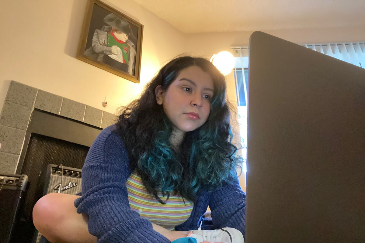 Susan Gonzalez types on her laptop in this photo.