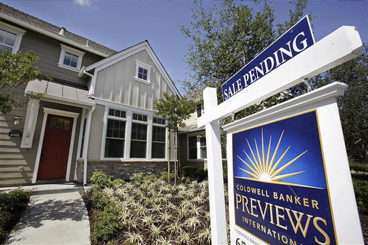 In this July 24 file photo, a pending home sale in Palo Alto, Calif. is shown.