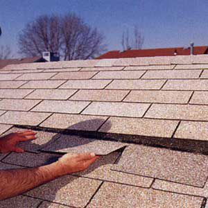 <p>2. Slide the new shingle up into place. Be sure to align with the shingles of either side.</p>