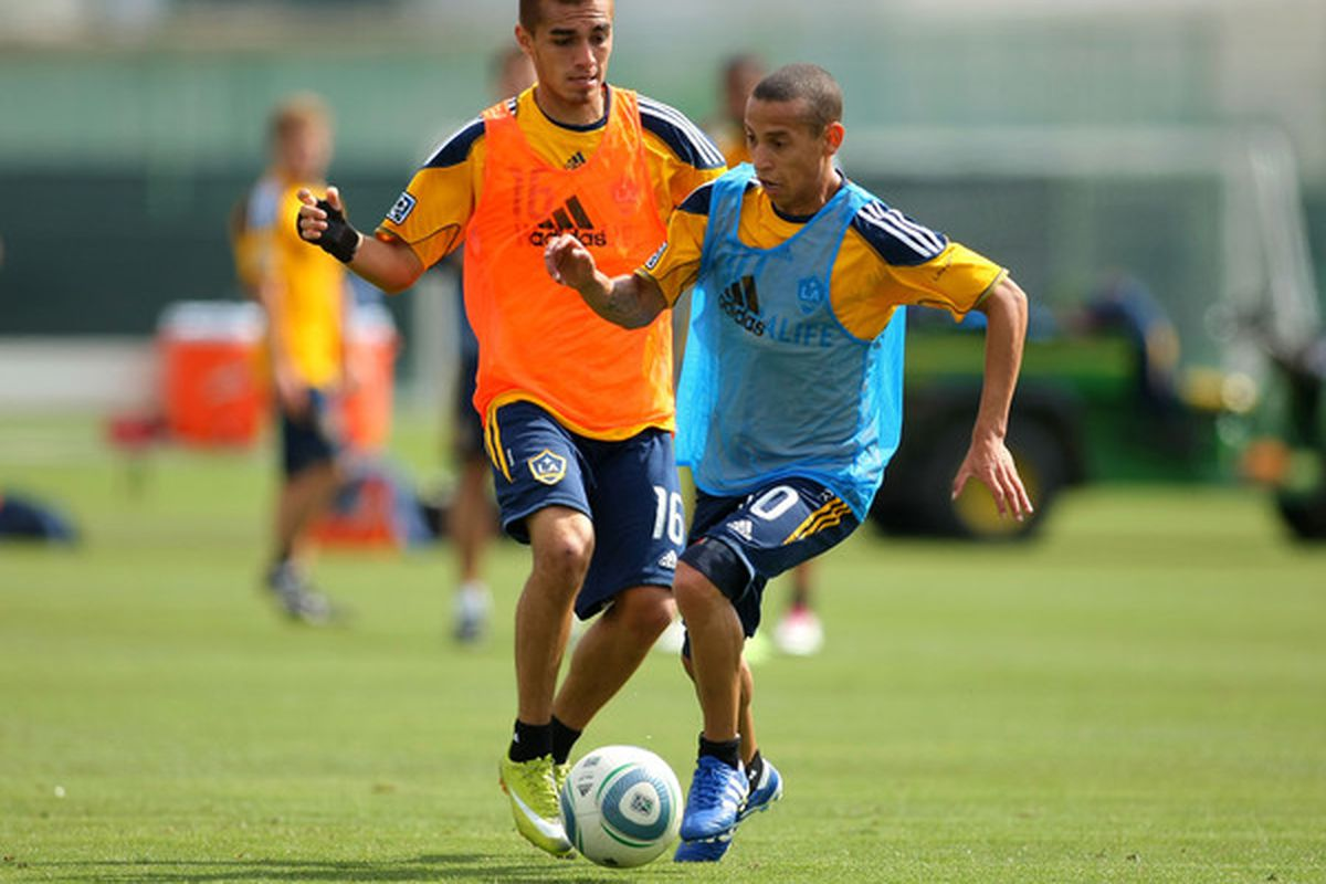 CARSON CA - FEBRUARY 24:  Hector Jimenez #16 and Paolo Cardozo #30 of the Los Angeles Galaxy vie for the ball during training at The Home Depot Center on February 24 2011 in Carson California.  (Photo by Victor Decolongon/Getty Images)