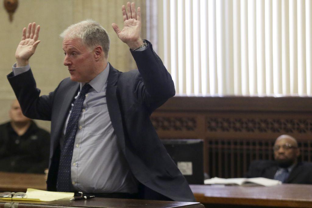 Attorney Scott Kamin speaks during opening statements in the trial of his client, Shomari Legghette, right, during Legghette's murder trial.