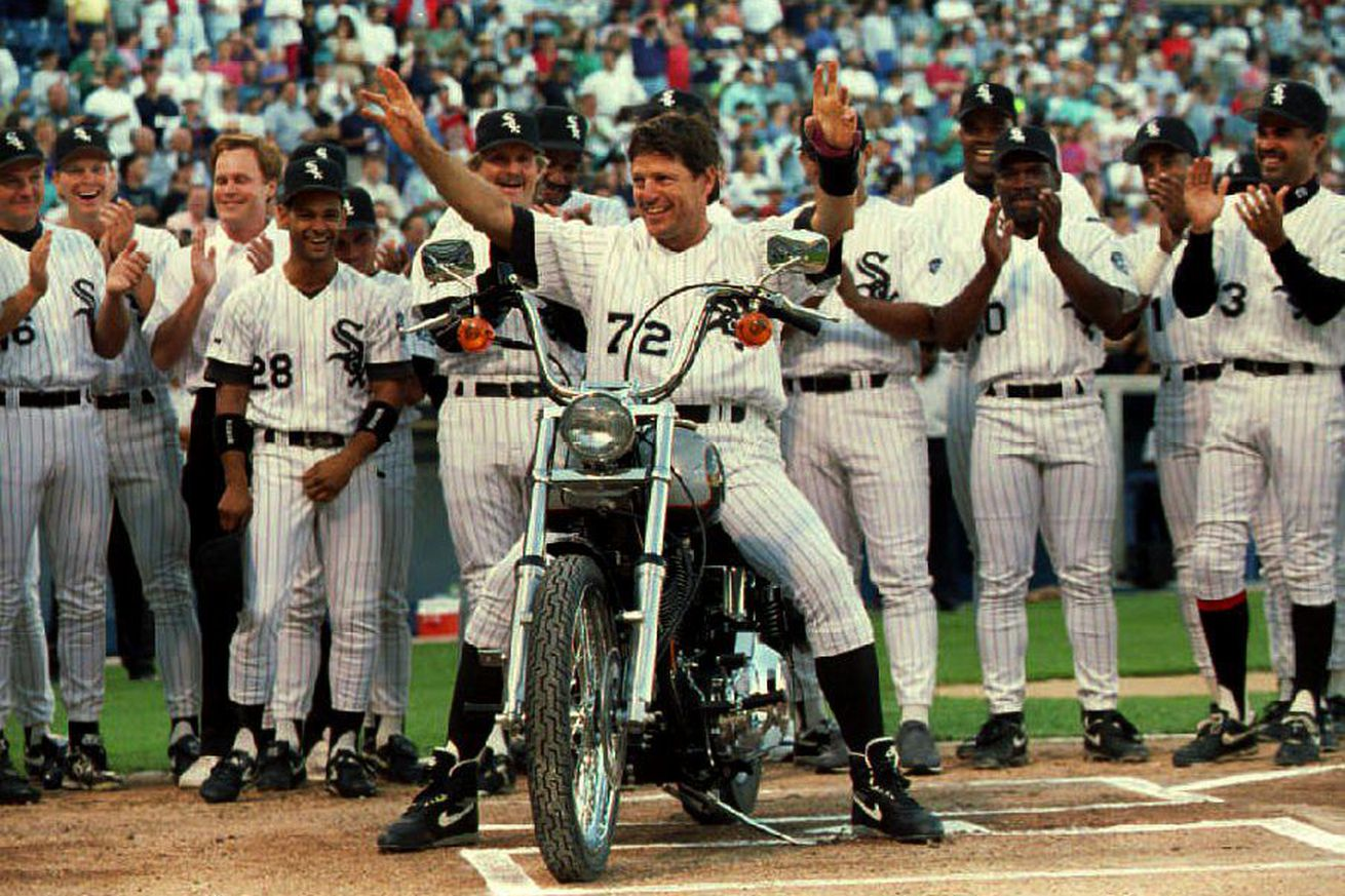 Chicago White Sox catcher Carlton Fisk(C) is given