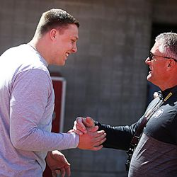 Garrett Bolles is greeted by Utah coach Kyle Whittingham during the annual Red & White Spring Game at Rice-Eccles Stadium in Salt Lake City on Saturday, April 15, 2017. Bolles is one of 22 prospects confirmed as attending the NFL draft in Philadelphia. The NFL draft begins April 27.