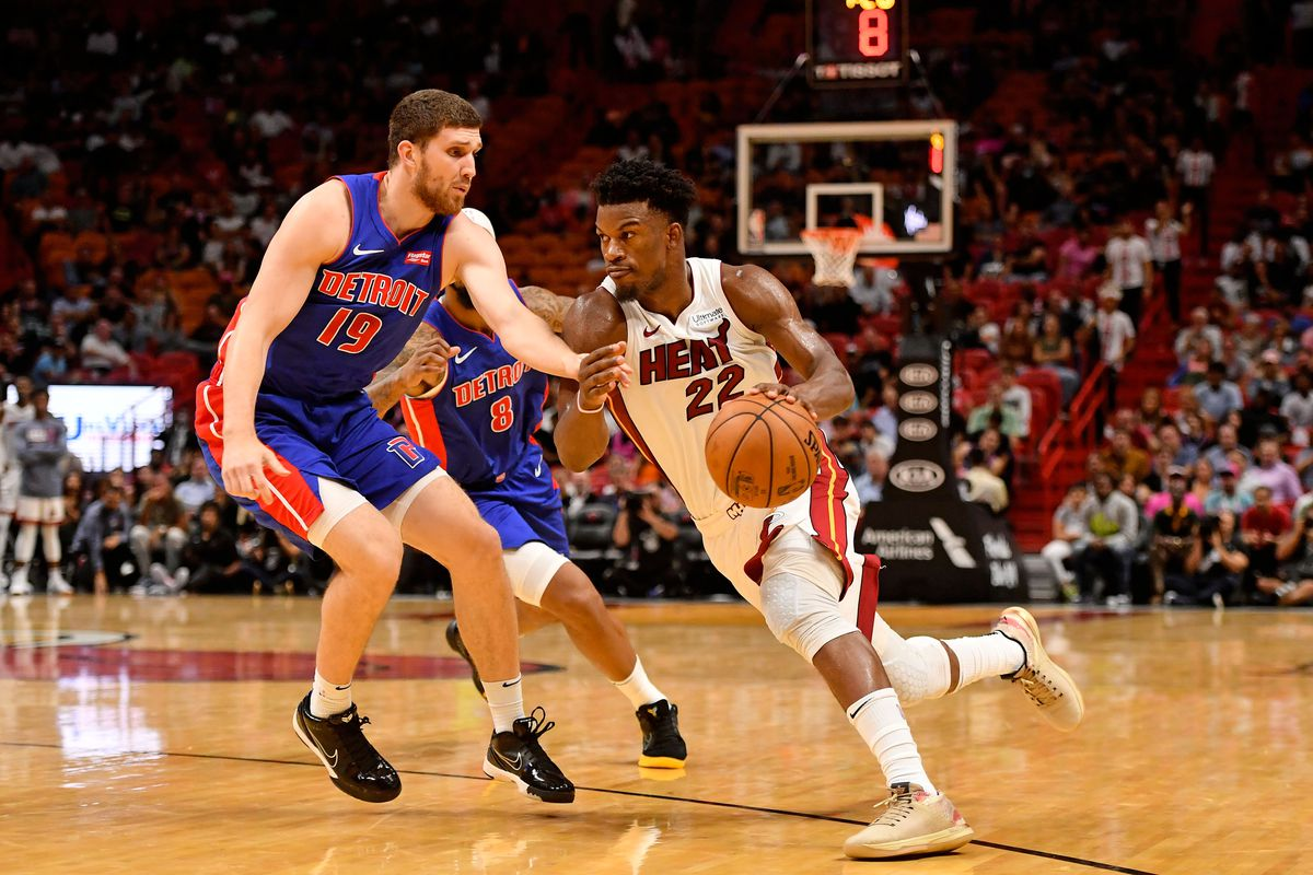 Miami Heat forward Jimmy Butler drives the ball around Detroit Pistons guard Sviatoslav Mykhailiuk during the second half at American Airlines Arena.