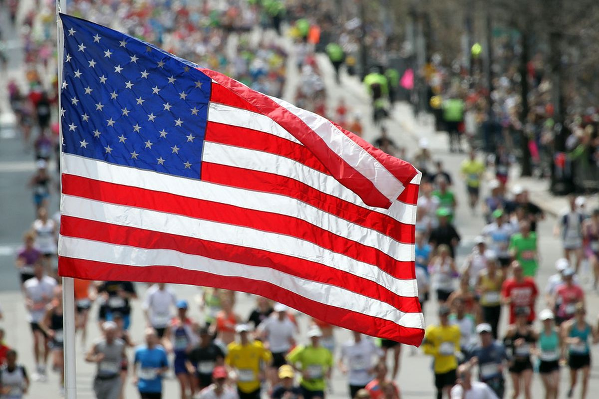 BOSTON, MA - APRIL 18:  An American flag is seen as runners make their way to the finish line during the 115th running of the Boston Marathon on April 18, 2011 in Boston, Massachusetts. (Photo by Jim Rogash/Getty Images)