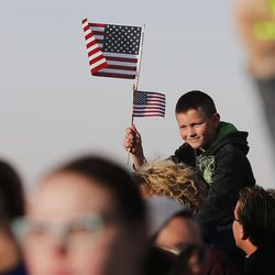 Cole Booher looks for his father, Sgt. Jim Booher, as soldiers from Detachment 2, 101st Airborne Division (Air Assault) return to Utah on Friday, Nov. 18, 2016, following an 11-month deployment to Iraq.