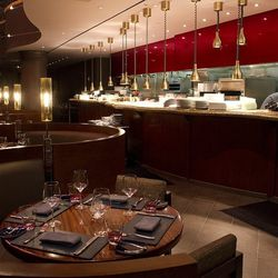 A view from the serpentine booths that line the open kitchen at Gordon Ramsay Steak.
