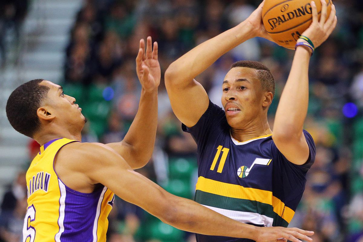 Utah Jazz guard Dante Exum (11) is defended by Los Angeles Lakers guard Jordan Clarkson (6) as the Utah Jazz open the home season with the LA Lakers in Salt Lake City on Friday, Oct. 28, 2016.