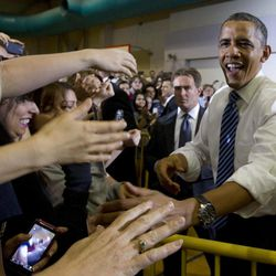 President Barack Obama greets people before speaking at the University of Iowa, Wednesday, April 25, 2012, in Iowa City, Iowa.