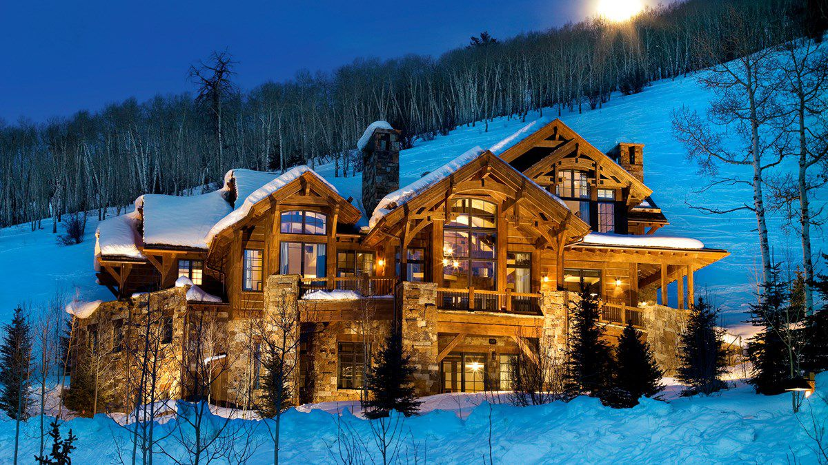 Large timber house in snow