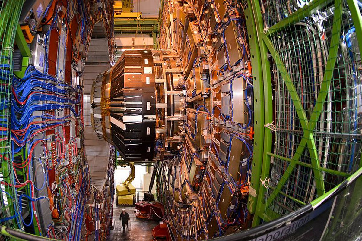 A worker stands below the Compact Muon Solenoid (CMS), a general-purpose detector at the European Organisation for Nuclear Research (CERN) Large Hadron Collider (LHC), during maintenance works on July 19, 2013.