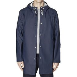 """<strong>Stutterhiem</strong> Stockholm Raincoat in Navy, <a href=""""http://www.atriumnyc.com/collections/stutterheim/products/stockholm-raincoat-in-navy"""">$369</a> at Atrium NYC"""