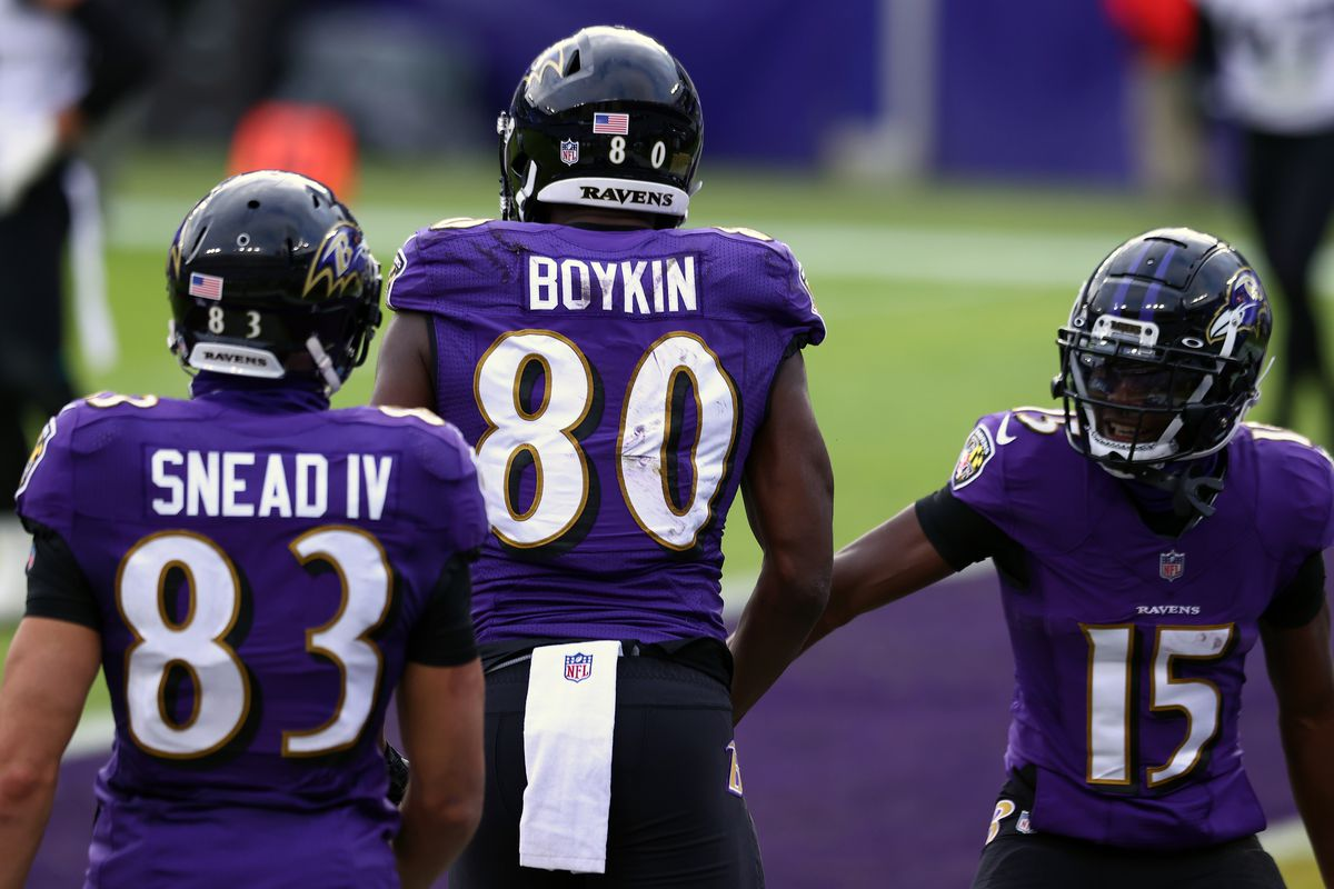 Wide receiver Miles Boykin #80 of the Baltimore Ravens celebrates with teammate wide receiver Marquise Brown #15 following a four yard touchdown reception during the first quarter of their game against the Jacksonville Jaguars at M&T Bank Stadium on December 20, 2020 in Baltimore, Maryland.