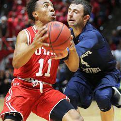 Utah Utes guard Brandon Taylor drives past BYU guard Nick Emery as Utah and BYU play in the Huntsman Center in Salt Lake City Wednesday, Dec. 2, 2015. Utah won 83-75.
