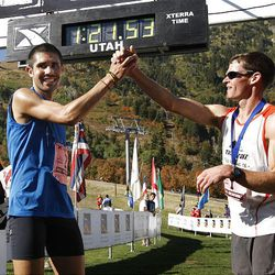 Mario Mendoza, left, who finished second, high fives Max King, from Bend, Ore., who won the XTERRA Trail Running National Championship Half Marathon race  Sunday, Sept. 25, 2011, in Snowbasin, Utah.