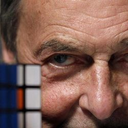 Erno Rubik, the inventor of the Rubik's Cube, poses for The Associated Press with cubes at Liberty Science Center, Wednesday, April 25, 2012, in Jersey City, N.J. The center will have an exhibit on the toys and will include a cube made with diamonds that is worth 2.5 million dollars.