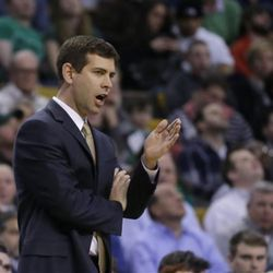 Boston Celtics head coach Brad Stevens has talks with a referee during the first half of an NBA basketball game against the Utah Jazz in Boston, Wednesday, March 4, 2015. (AP Photo/Elise Amendola)