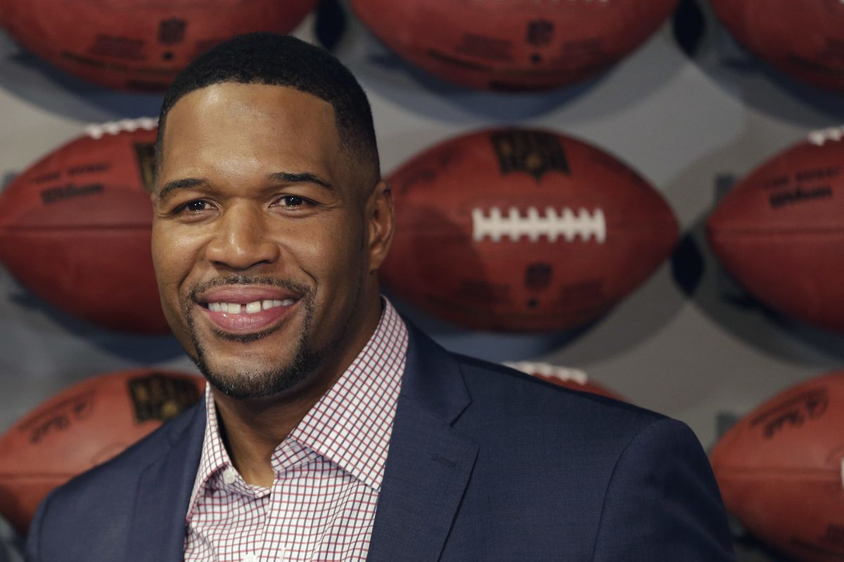 """Michael Strahan, a Pro Football Hall of Famer and co-host of """"Fox NFL Sunday"""" and """"Good Morning America,"""" has tested positive for COVID-19 and is self-quarantining,"""
