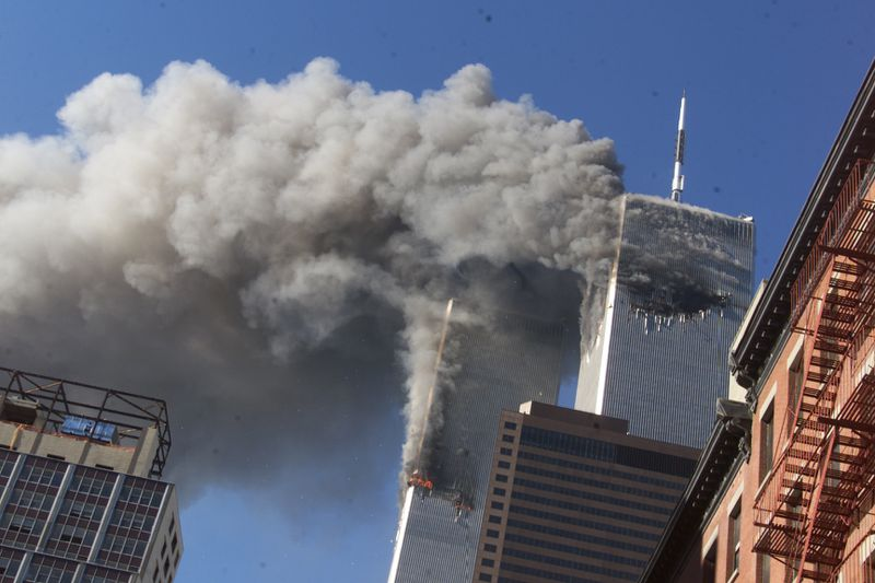 Smoke rises from the burning twin towers of the World Trade Center after hijacked planes crashed into the towers on Sept. 11, 2001.