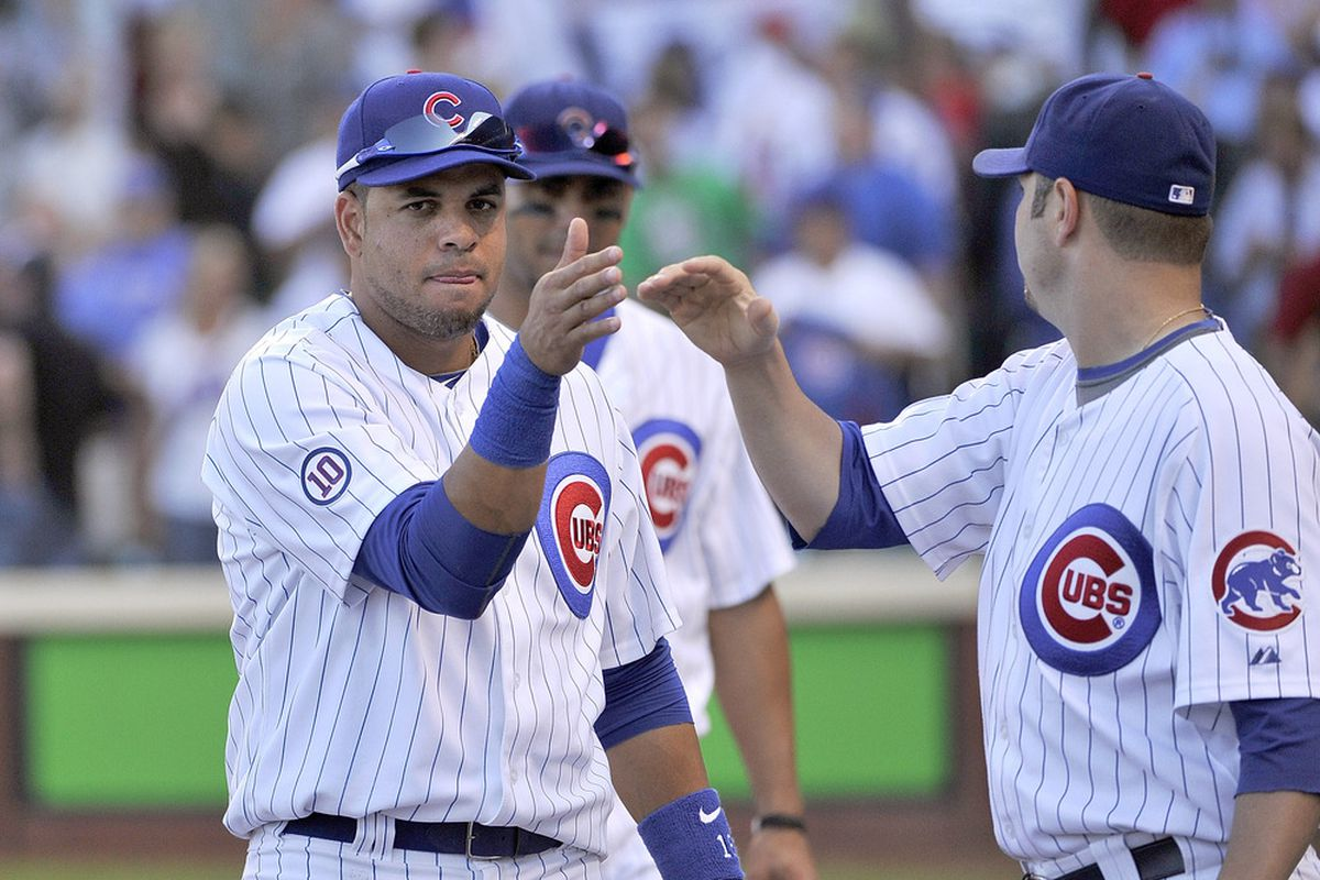 Aramis Ramirez and John Grabow of the Chicago Cubs celebrate their 3-0 win over the St. Louis Cardinals at Wrigley Field in Chicago, Illinois.  (Photo by Brian Kersey/Getty Images)