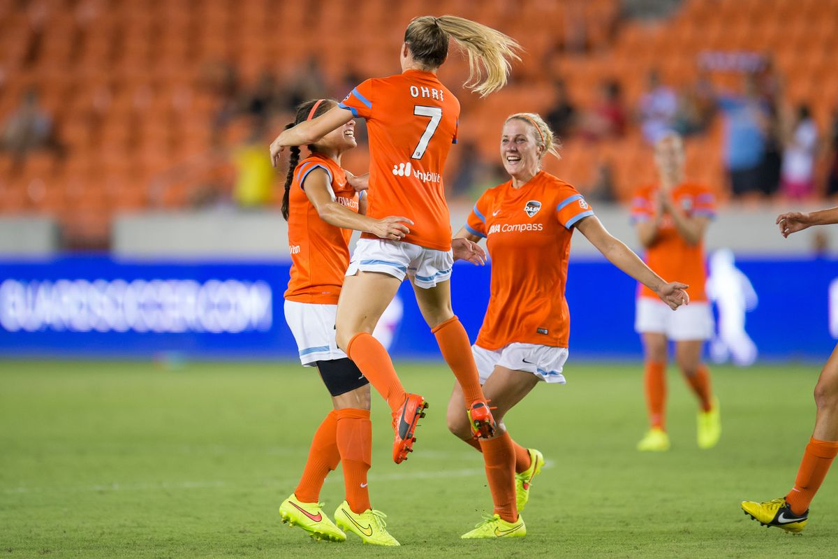 Kealia Ohai celebrates the first of her two goals with fellow teammates Arianna Romero and Becky Edwards