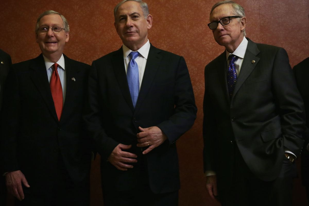 Netanyahu schmoozes with Congressional leaders of the kind he's accused of leaking intelligence on the US to.