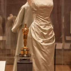 Kelly wore this Edith Head-designed satin dress and matching full-length evening coat to receive her 1955 Oscar for her role in <em>Country Girl</em>. [Image credit: Natalie Wi]