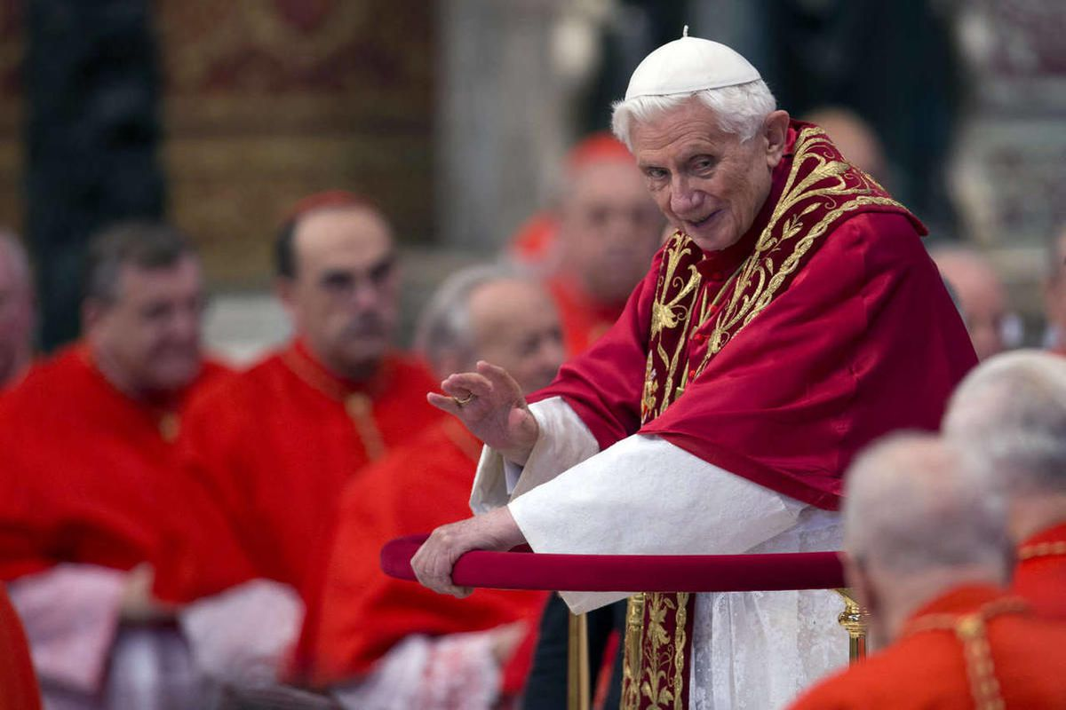 Pope Benedict XVI makes his way through cardinals as he arrives inside St. Peter's Basilica at the Vatican to preside over a consistory, Saturday, Nov. 24, 2012.