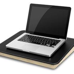Working from home has never been this comfy. Why work at a desk when you can sit on a couch and get just as much work done with Judge Judy playing in the background? This <b>Creative Essentials Executive Lap Desk</b> —available for <b>$14.97</b> fro