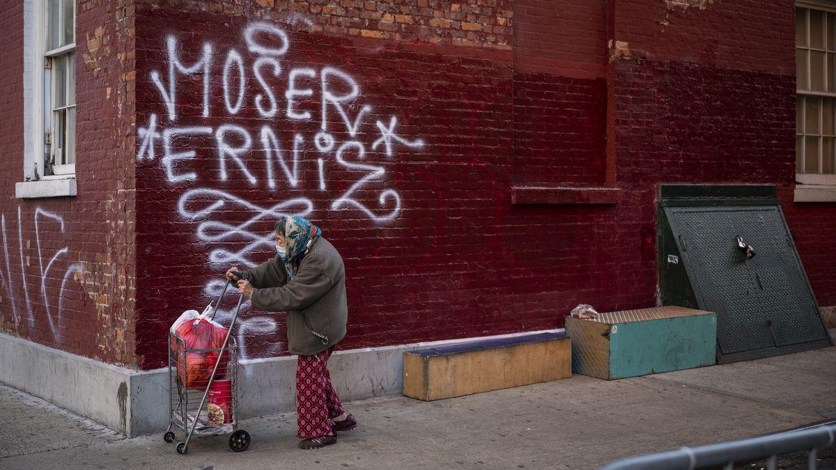 An elderly pedestrian in Chinatown.