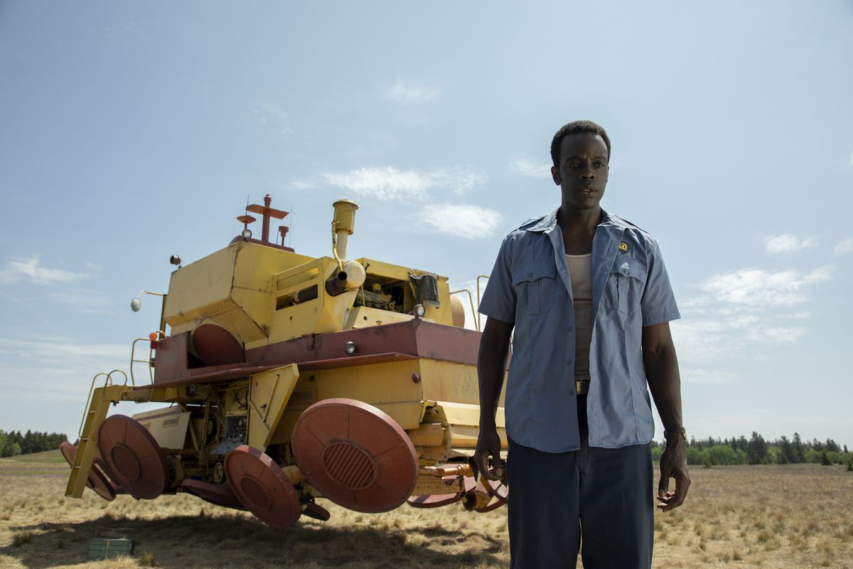 The security guard from the laboratory in front of his pet project, an anti-gravity farm implement.