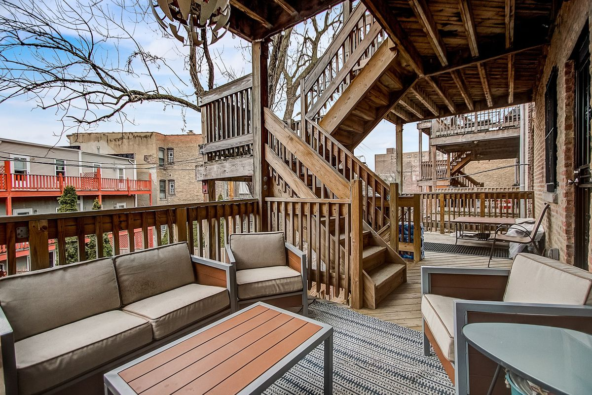 A view of the back deck with lounge charis.