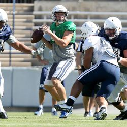 QB Taysom Hill looks to pass during a scrimmage at BYU in Provo on Saturday, Aug. 15, 2015.