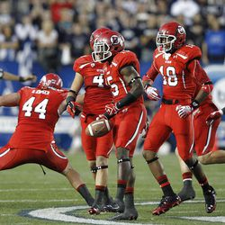 Utah Utes defensive back Michael Walker (15) celebrates with teammates after he recovered a fumble as the University of Utah and Brigham Young University play football Saturday, Sept. 17, 2011, in Provo, Utah.