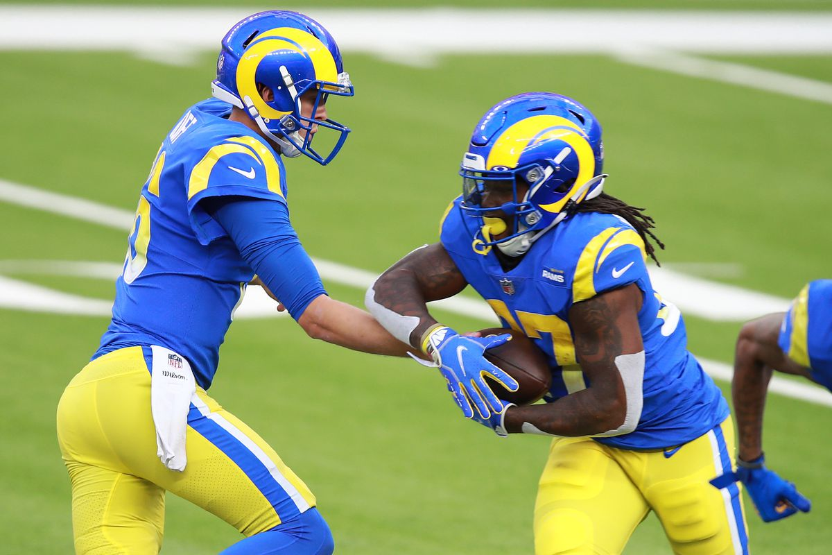 Jared Goff #16 of the Los Angeles Rams hands the ball off to Darrell Henderson Jr. #27 during the first half against the San Francisco 49ers at SoFi Stadium on November 29, 2020 in Inglewood, California.