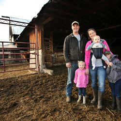 Addison and Jenn Hicken pose for a photo with their kids Laynie, Ren and Evan on their farm in Heber City on Wednesday, March 11, 2020.