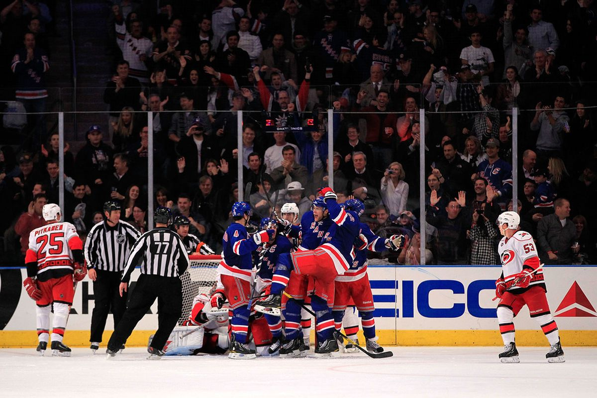 NEW YORK - NOVEMBER 11: Dan Girardi #5 of the New York Rangers celebrates a goal against the Carolina Hurricanes at Madison Square Garden on November 11, 2011 in New York City.  (Photo by Chris Trotman/Getty Images)