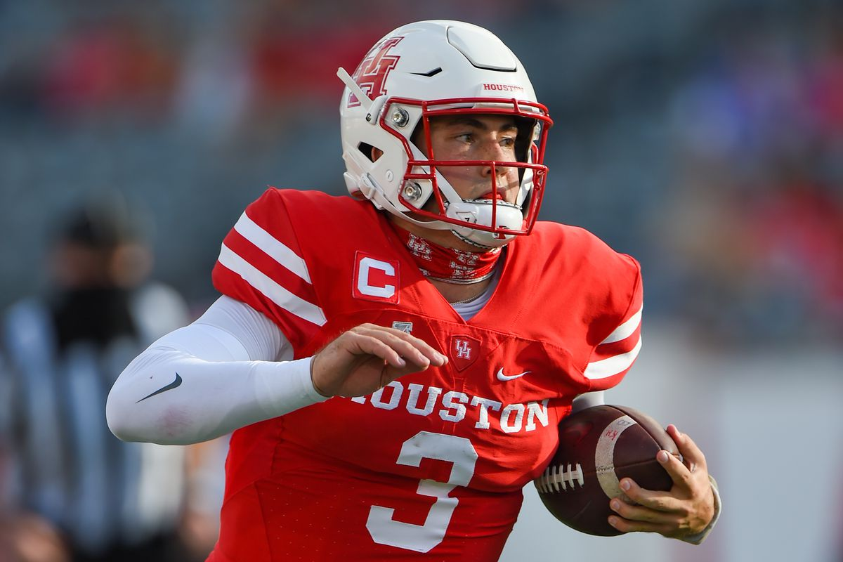 Houston Cougars quarterback Clayton Tune cuts to the outside during the football game between the University of South Florida Bulls and Houston Cougars at TDECU Stadium on November 14, 2020 in Houston TX.